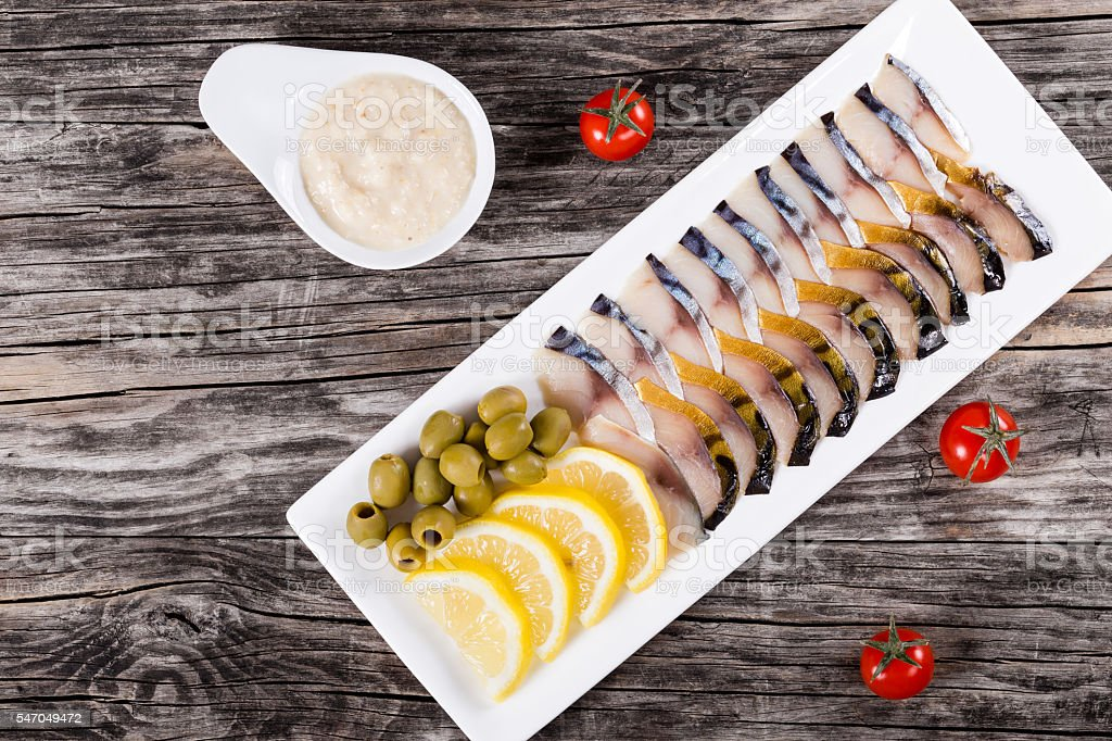 slices of smoked and marinated fish mackerel or scomber stock photo