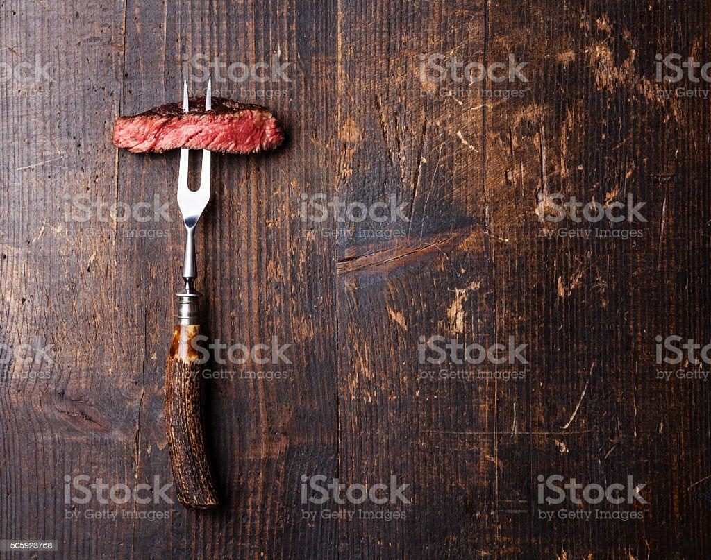 Slices of Steak Ribeye on meat fork stock photo