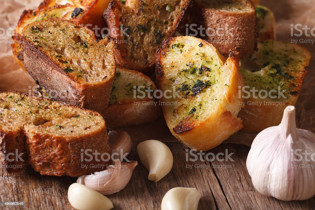 Slices of toasted bread with herbs and garlic. horizontal, rusti stock photo