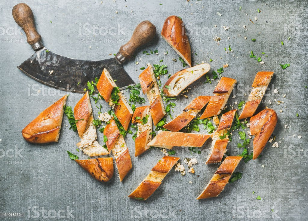Slices of turkish pizza pide and herb chopper stock photo
