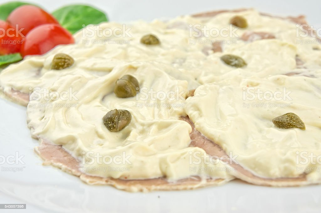 Slices of veal with tuna sauce and capers stock photo