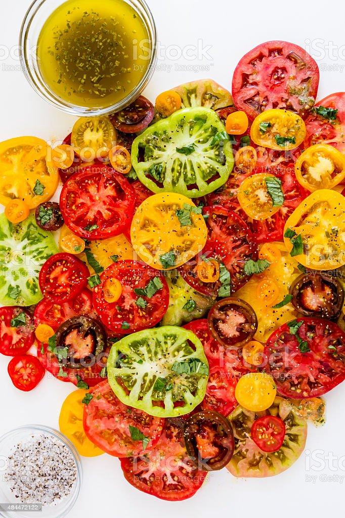 Slices of vine ripe tomato varieties stock photo