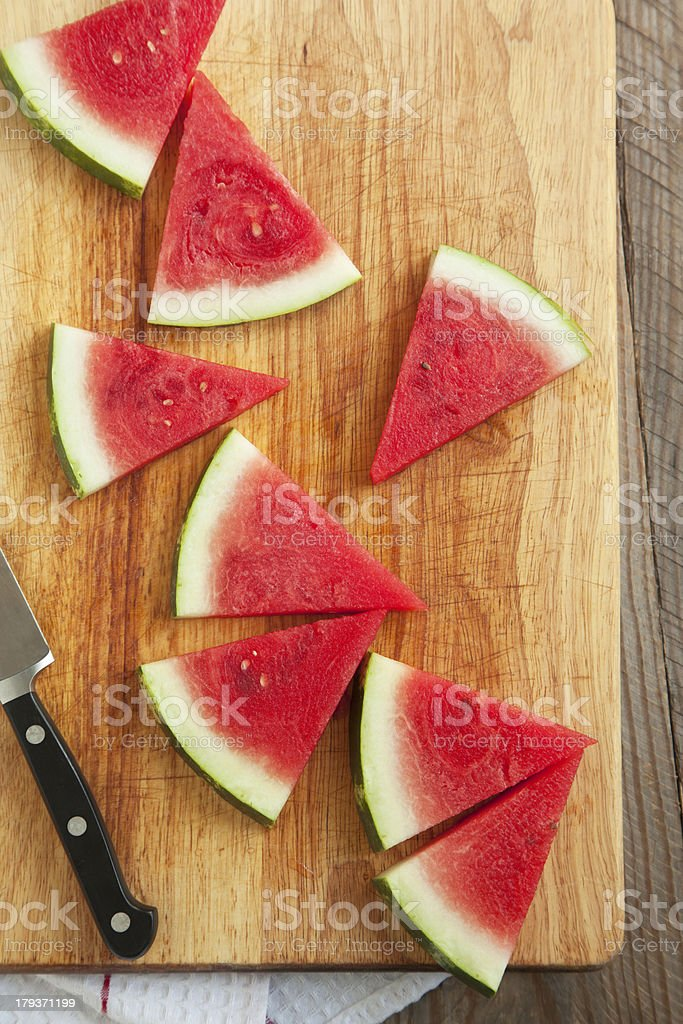 Slices of watermelon on wooden chopping board royalty-free stock photo