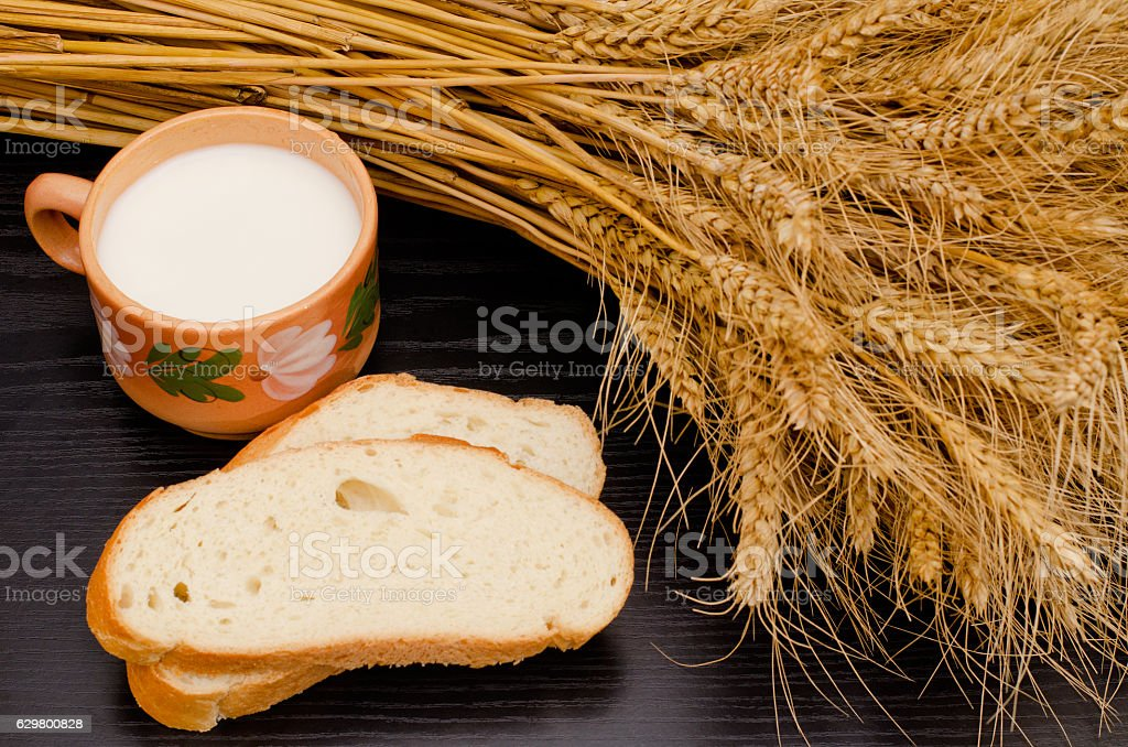 Slices of white bread and mug of milk stock photo