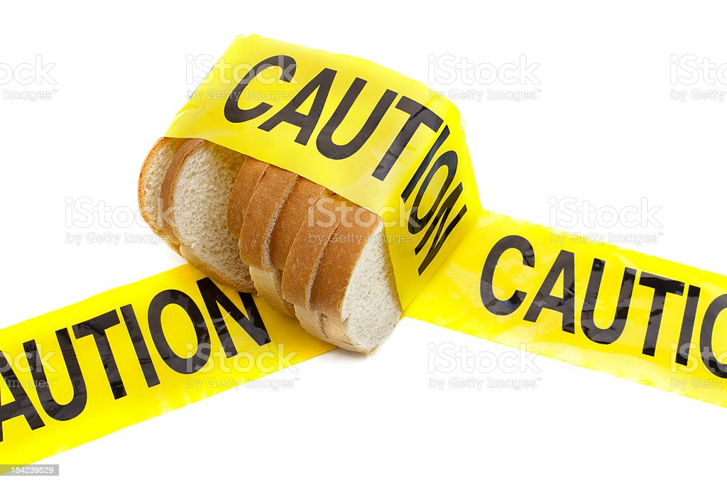 Slices of white bread with yellow caution tape around them  stock photo