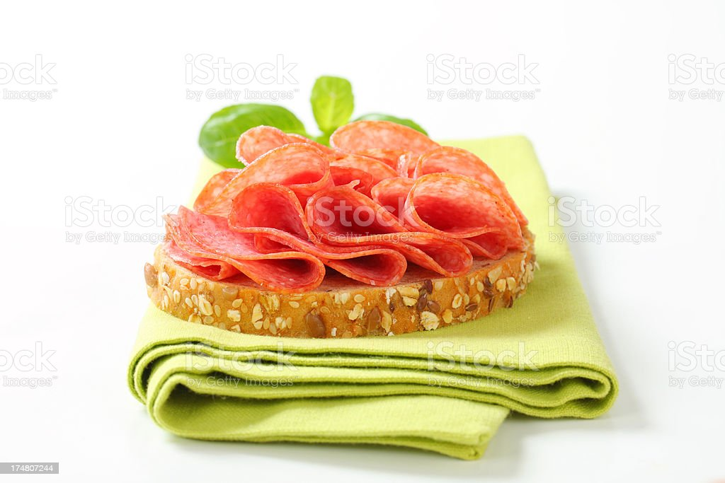 Slices of whole bread with Italian salami royalty-free stock photo
