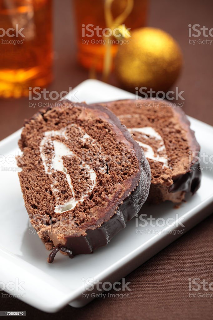 slices of yule log cake on a christmas table royalty free stock photo - Christmas Yule Log Cake