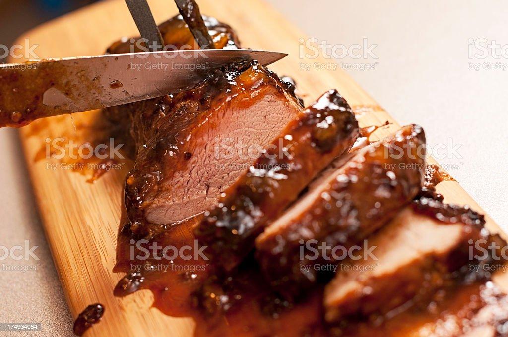 Slicing a barbecue pork tenderloin stock photo