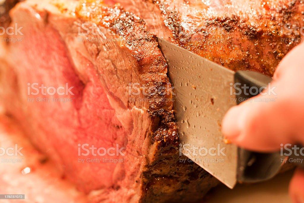 Slicing a Prime Rib stock photo