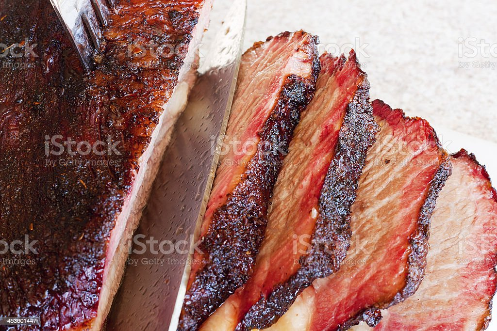 Slicing a Smoked Beef Brisket stock photo