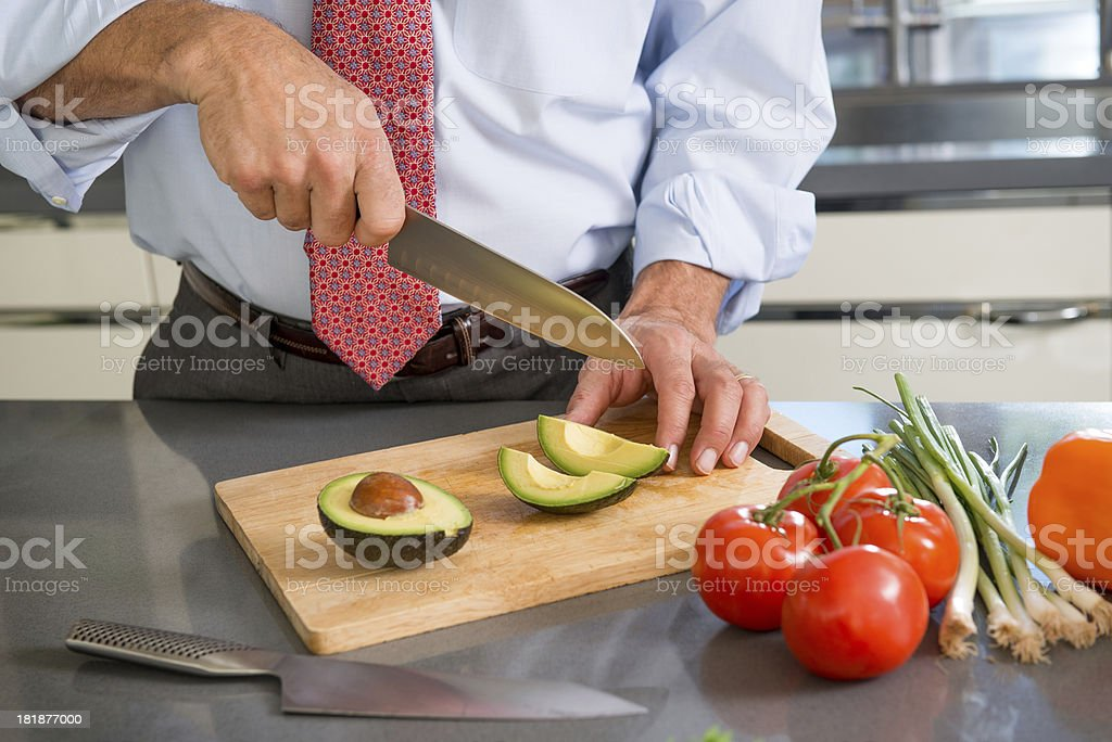 Slicing Avocados royalty-free stock photo