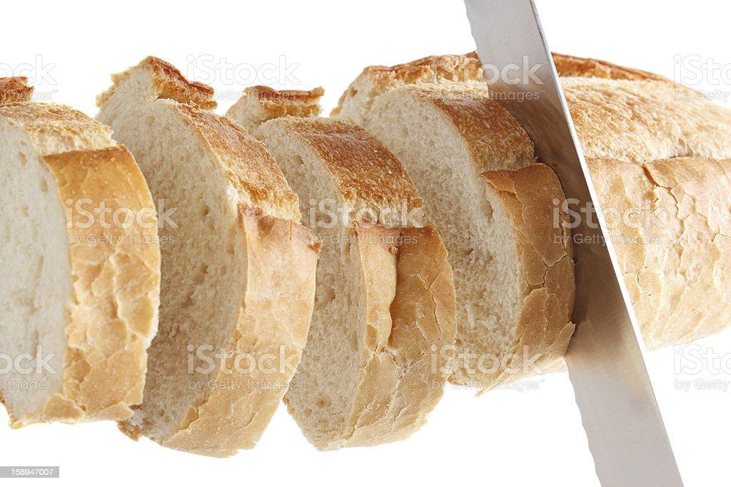 Slicing bread royalty-free stock photo