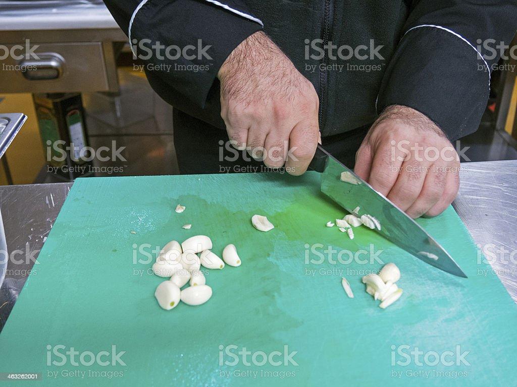 Slicing garlic royalty-free stock photo