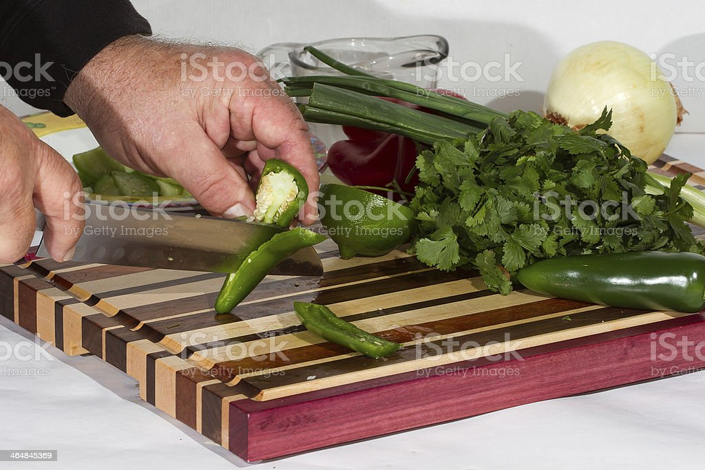 Slicing Jalapenos For Salsa royalty-free stock photo