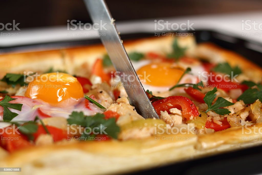 Slicing pie. Making Chicken and Egg Galette Series. stock photo