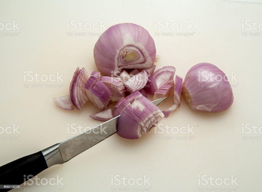Slicing Shallots stock photo