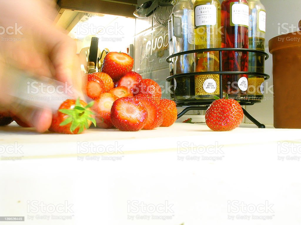 Slicing strawberries royalty-free stock photo