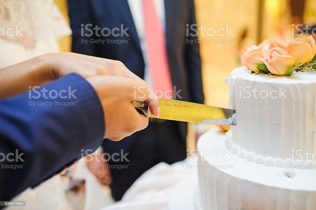 Slicing the cake stock photo