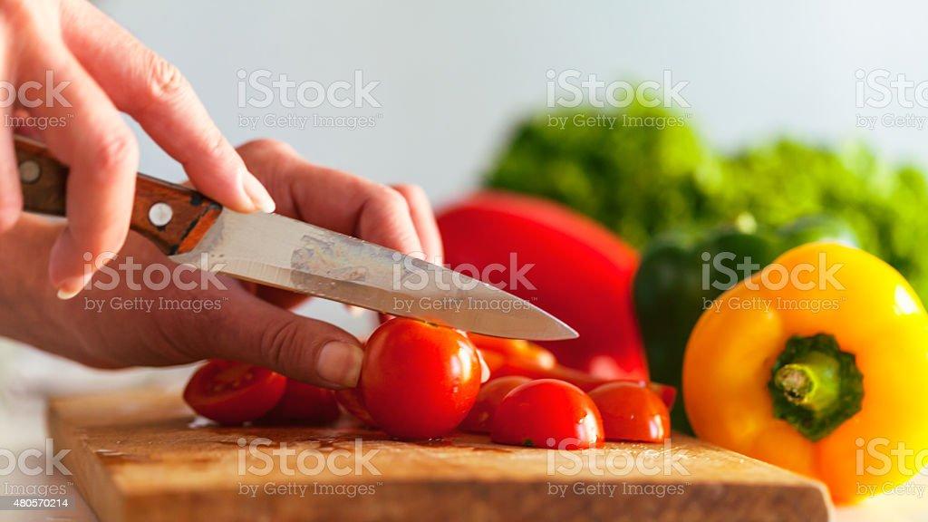slicing tomato stock photo