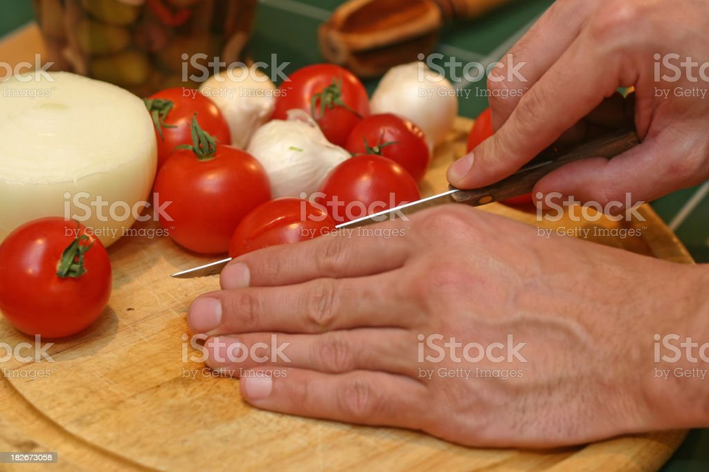Slicing Tomatoes royalty-free stock photo