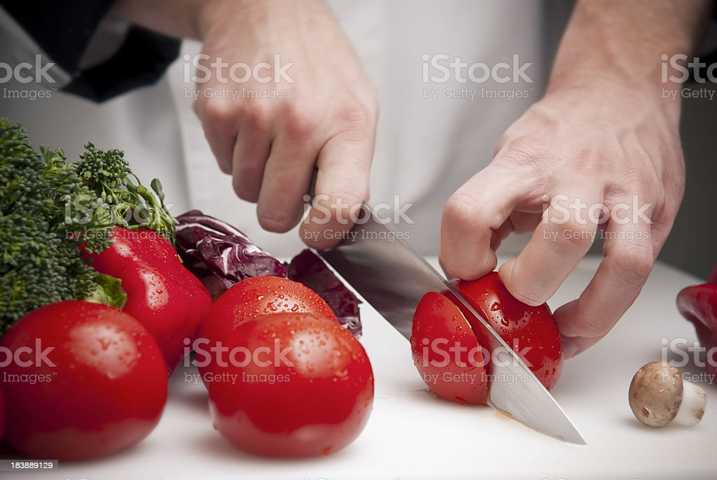 Slicing Tomatoes stock photo