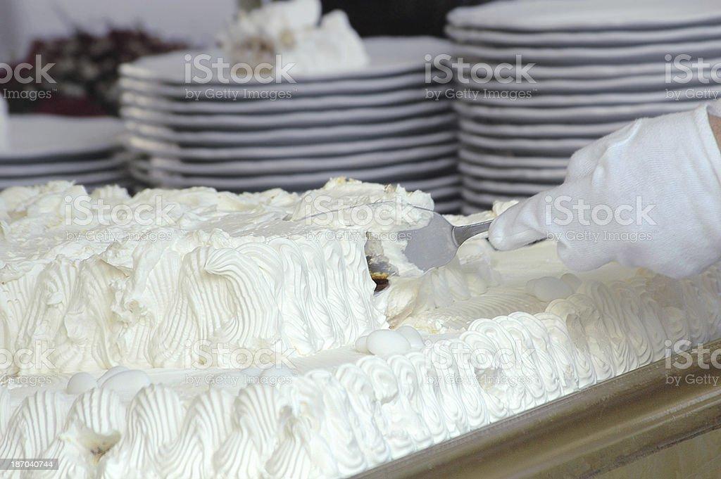 slicing wedding cake royalty-free stock photo