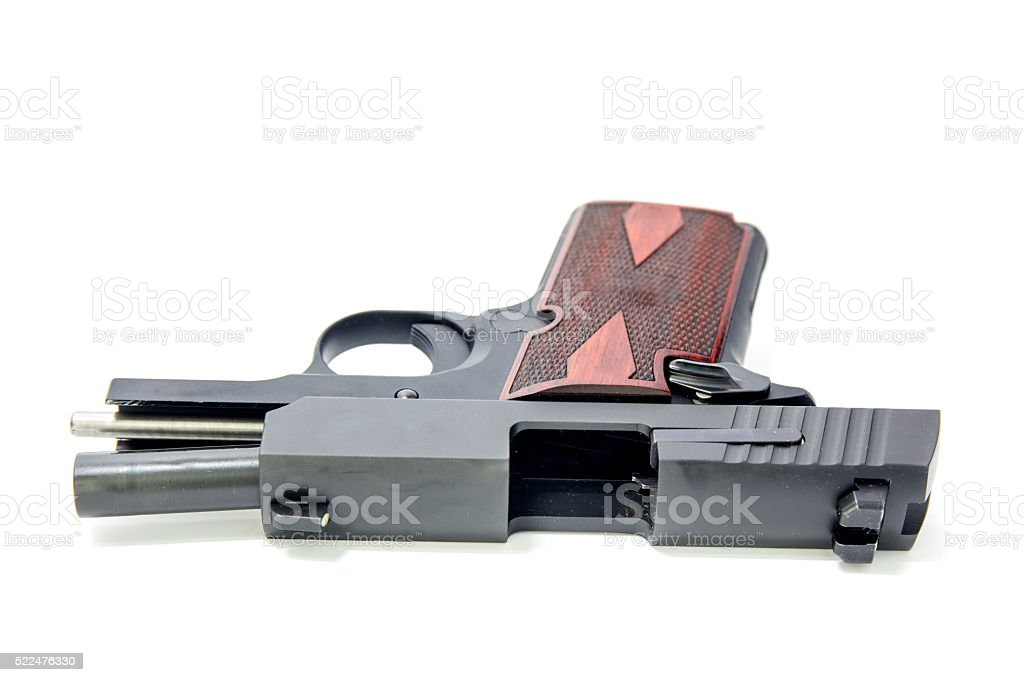 slide hold and ejection port of pistol isolated stock photo