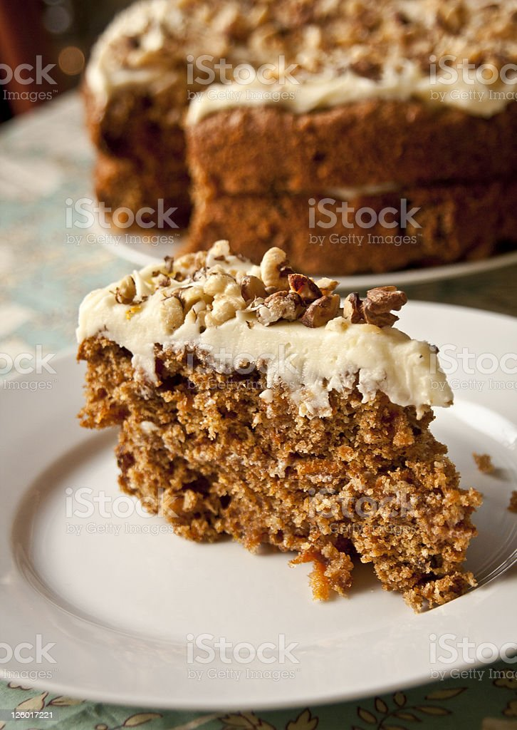 Slide of carrot cake with nuts for topping stock photo