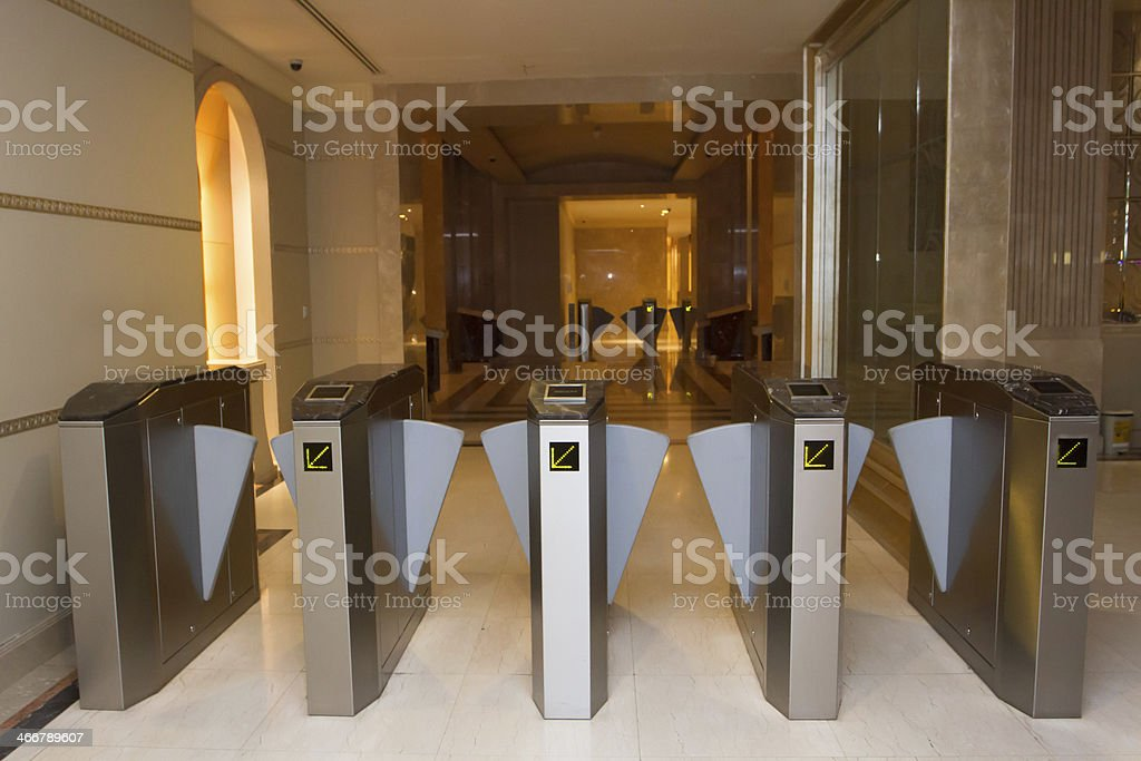 Slide open security gates at a pedestrian entrance royalty-free stock photo