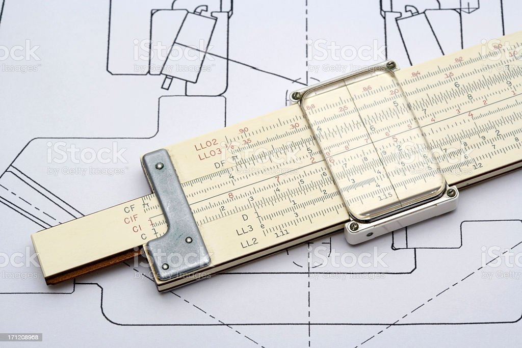 Slide Rule and a mechanical drawing stock photo