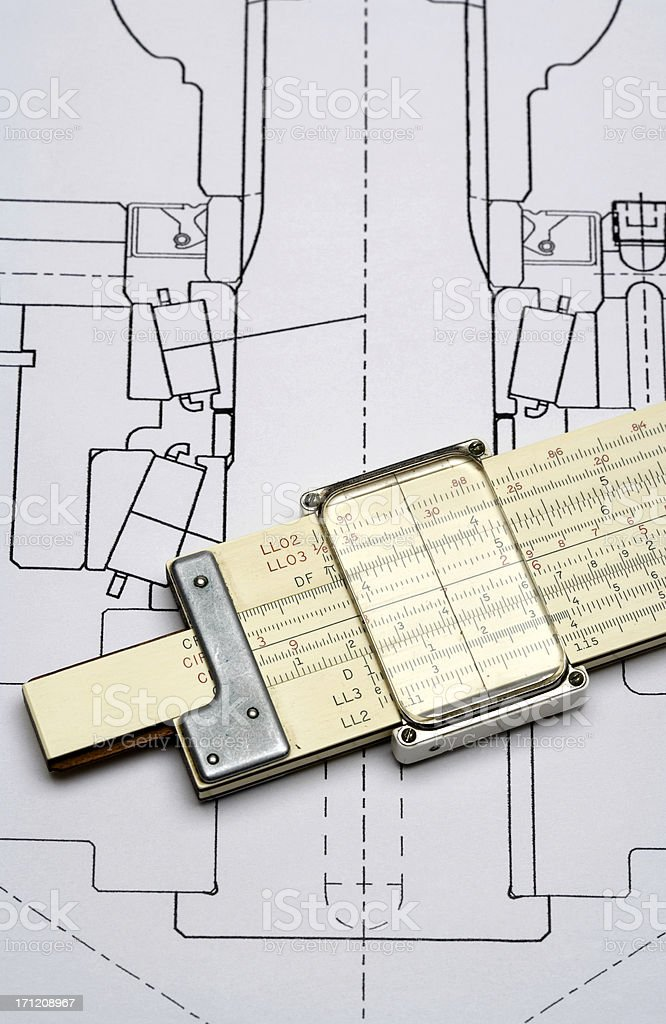 Slide Rule and mechanical drawing royalty-free stock photo