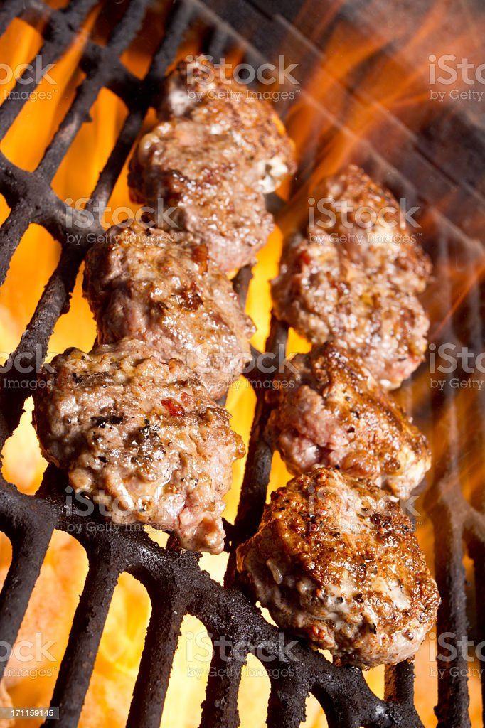 Sliders on a Grill with Flames stock photo