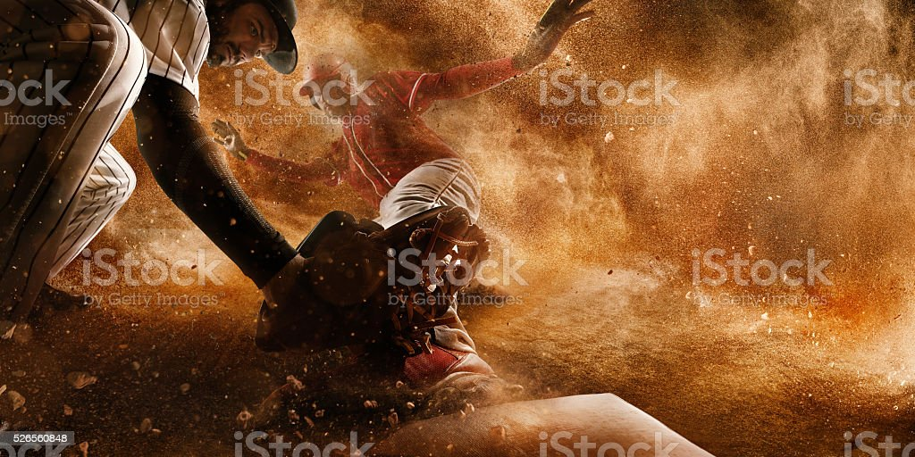 Sliding and tagging on third base stock photo
