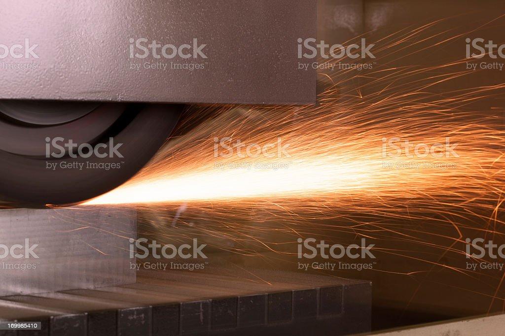 Sliding grinder with sparks stock photo