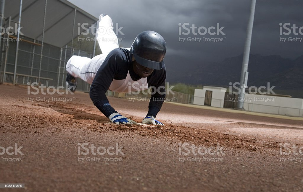 Sliding Headfirst Into Home stock photo