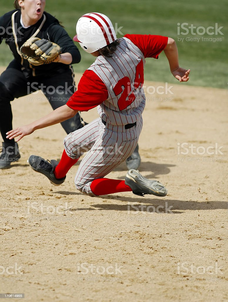 Sliding into second base stock photo