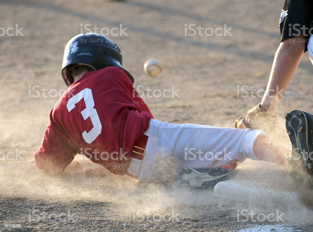 Sliding into third stock photo