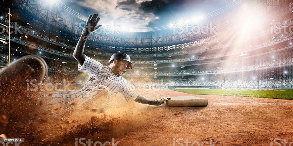 Sliding on third base stock photo
