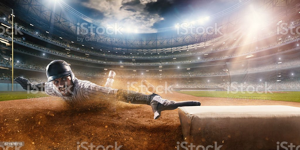Sliding on third base stock photo