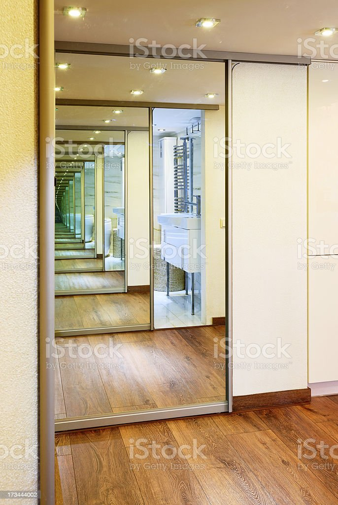 Sliding-door mirror wardrobe in modern hall interior with infini stock photo