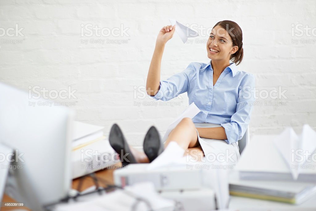 Slightly distracted at her desk stock photo