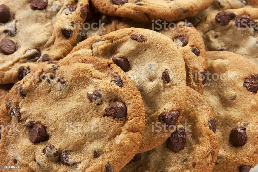 Slightly overdone chocolate chip cookies in a messy pile stock photo