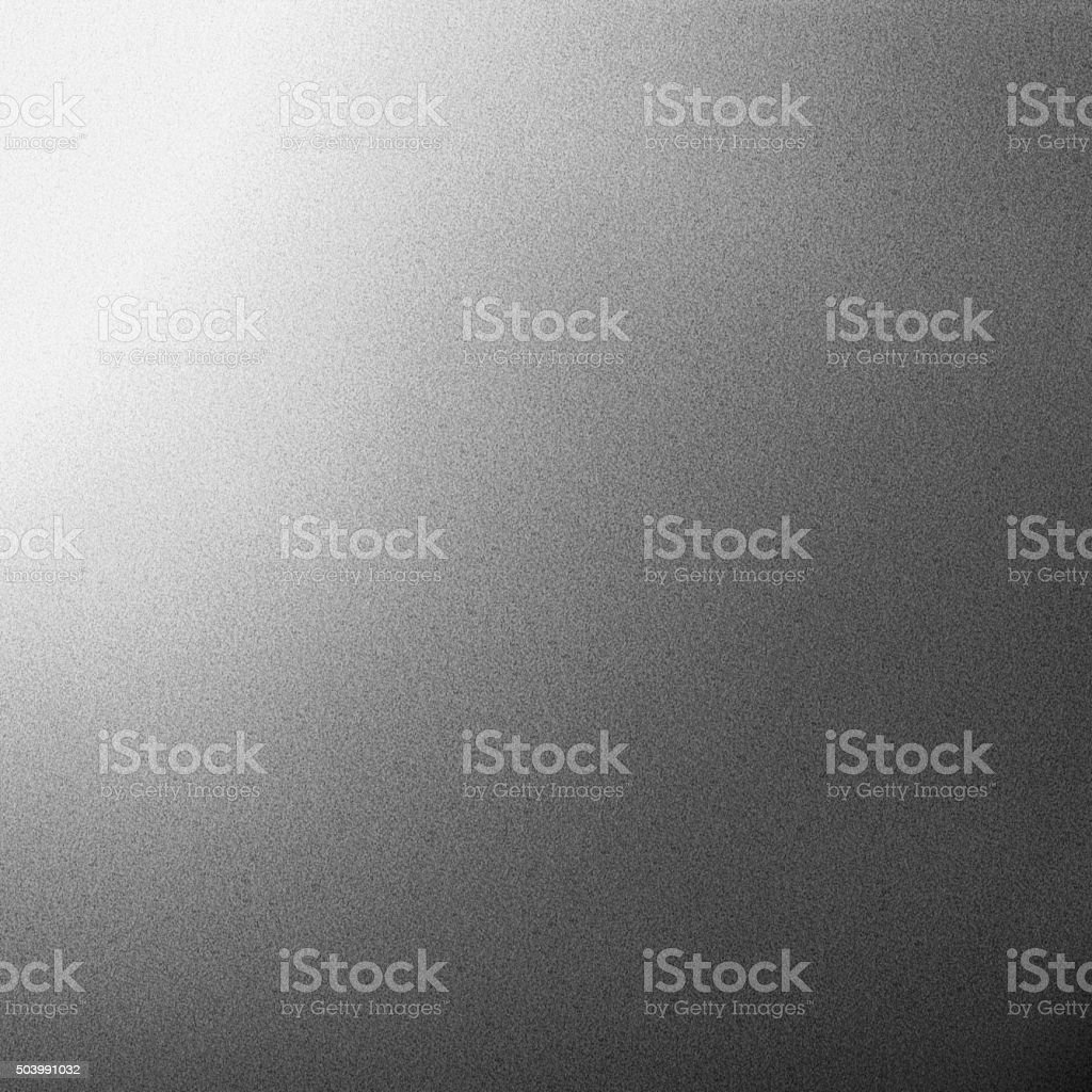 Slighty Grained Grey Background with Light Effect stock photo