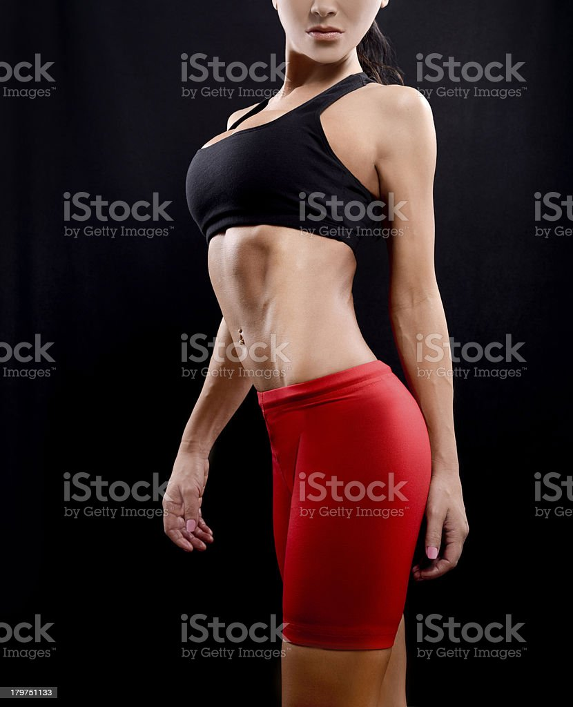 Slim and fit female sports figure royalty-free stock photo