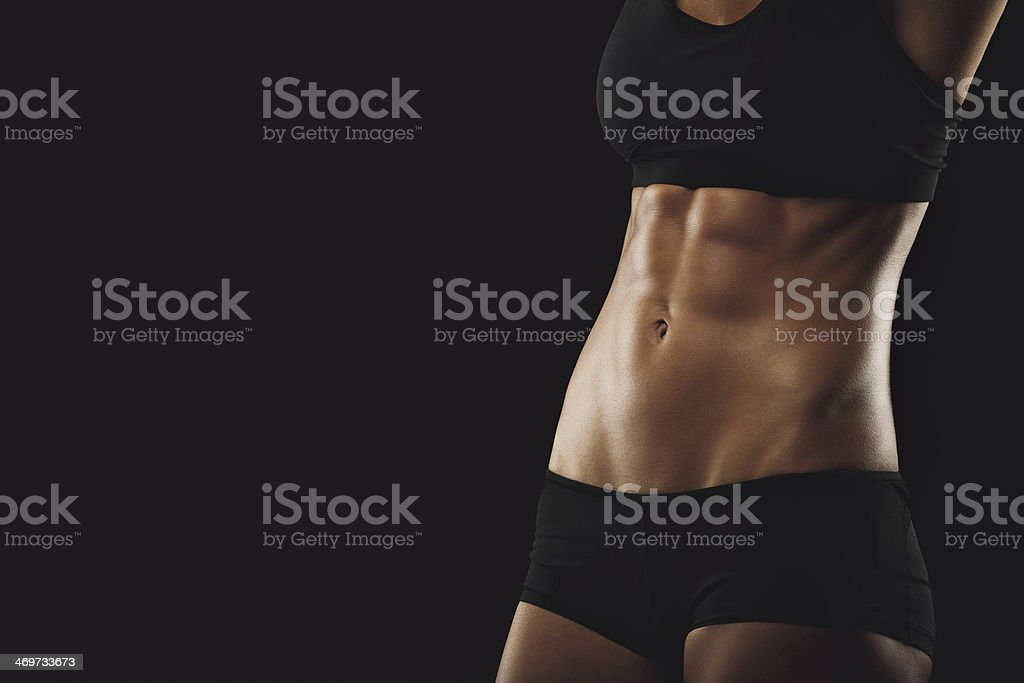 Slim and fit woman belly stock photo