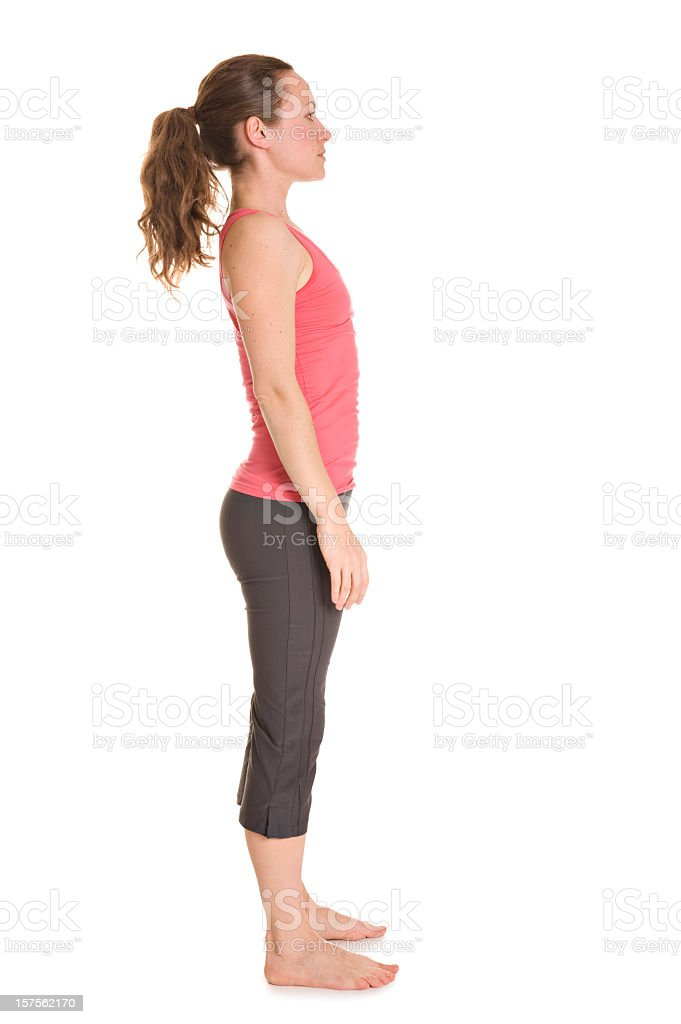 Slim female in exercise clothes doing a yoga pose stock photo
