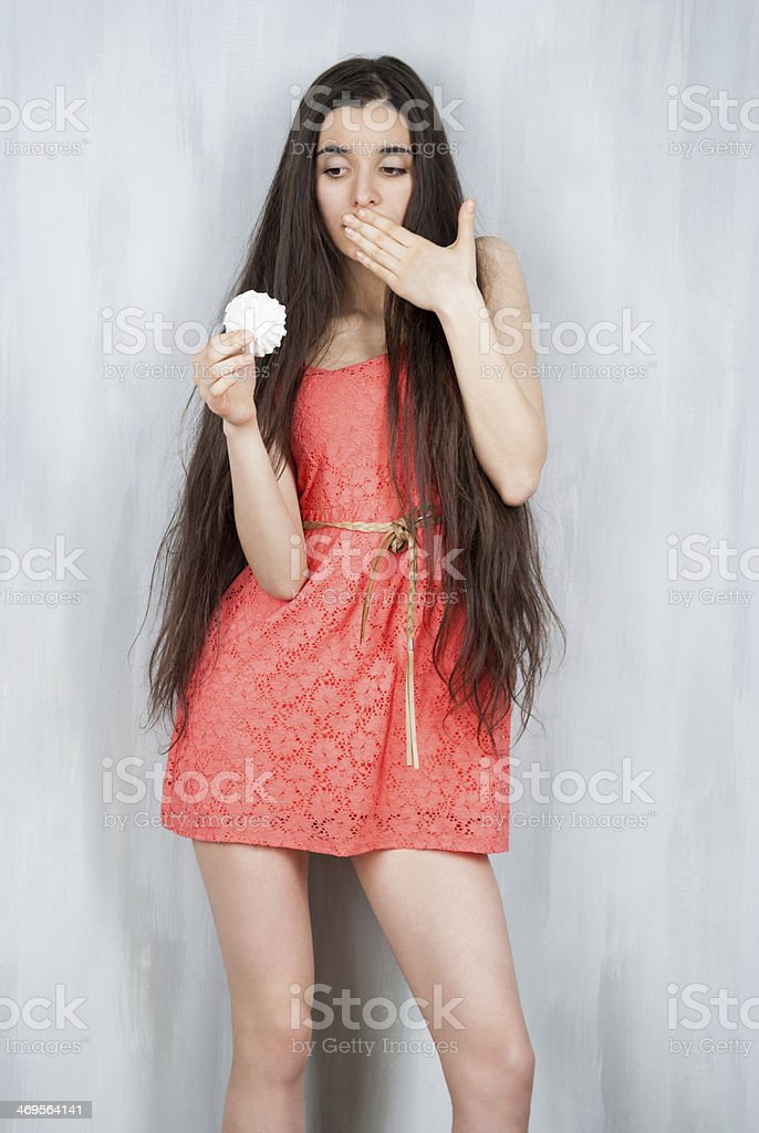 Slim girl avidly look at zephyr stock photo