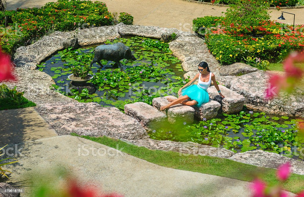 Slim girl in a swimsuit having pleasure and relaxing stock photo