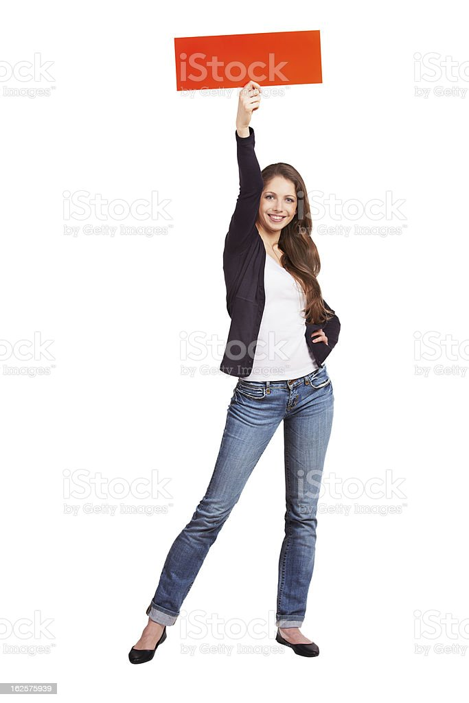 Slim long-haired girl advertises a sale royalty-free stock photo
