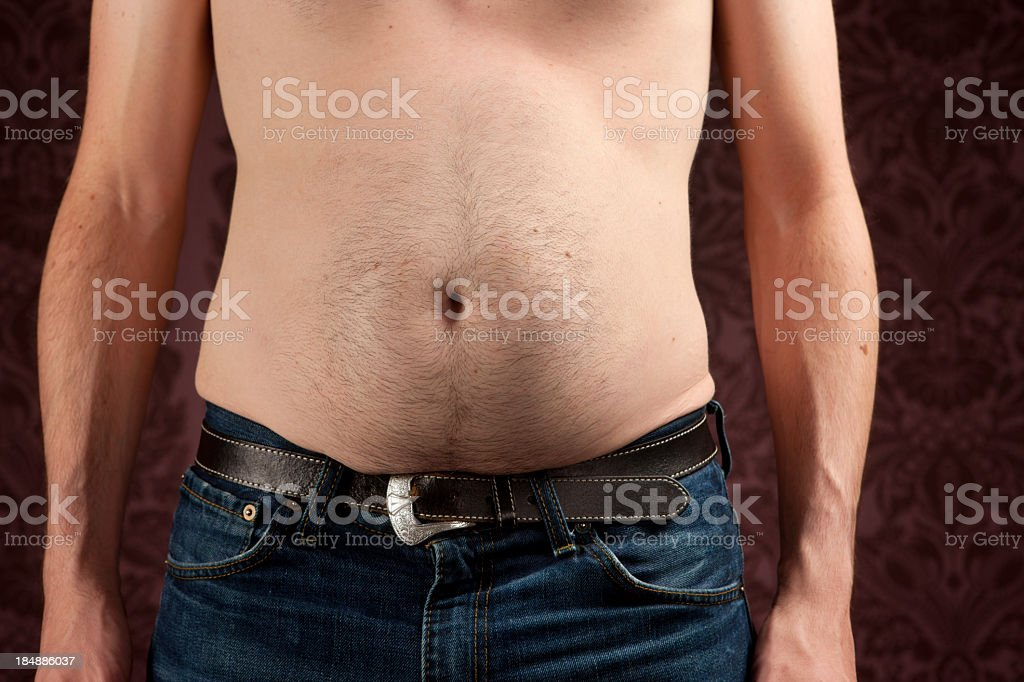 Slim man with a fat belly royalty-free stock photo